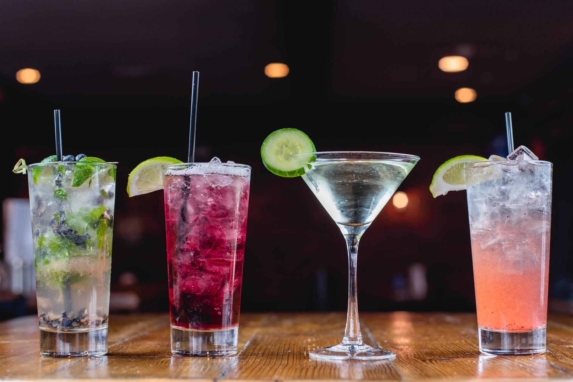a mojito, martini, and two other mixed drinks