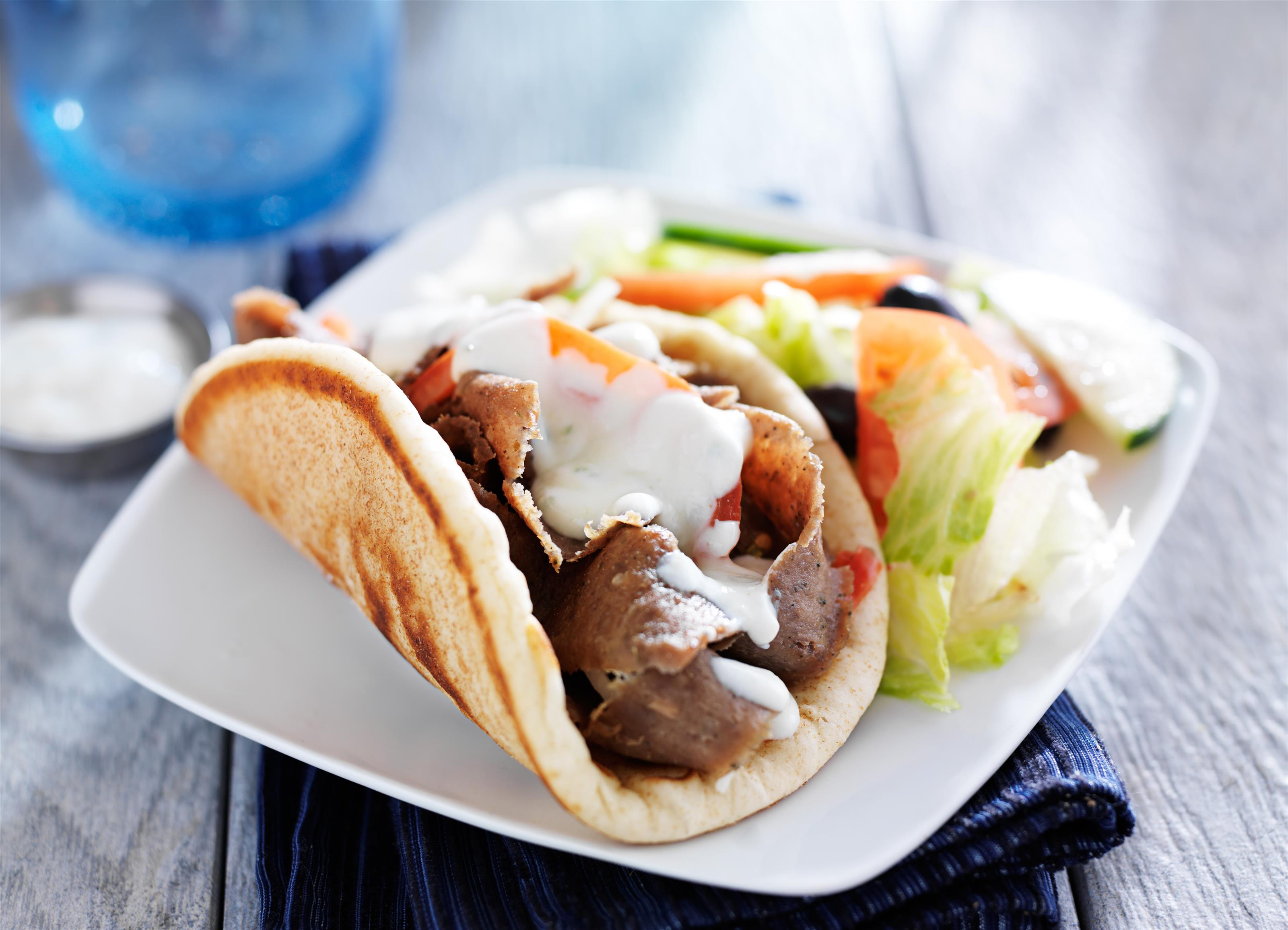 gyro on pita with lettuce on side