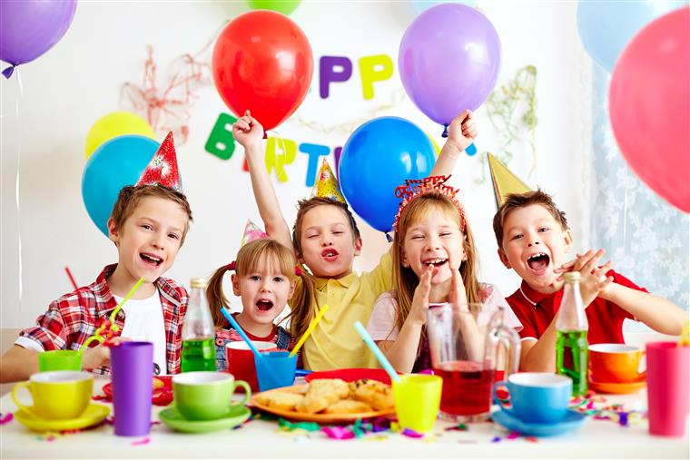 Kids laughing at a birthday party.