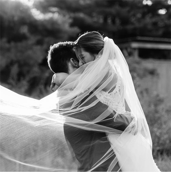 Bride & Groom Embracing - Flowing Vail