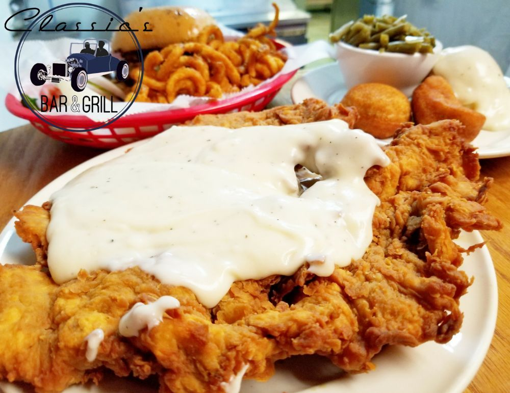 country fried steak topped with gravy