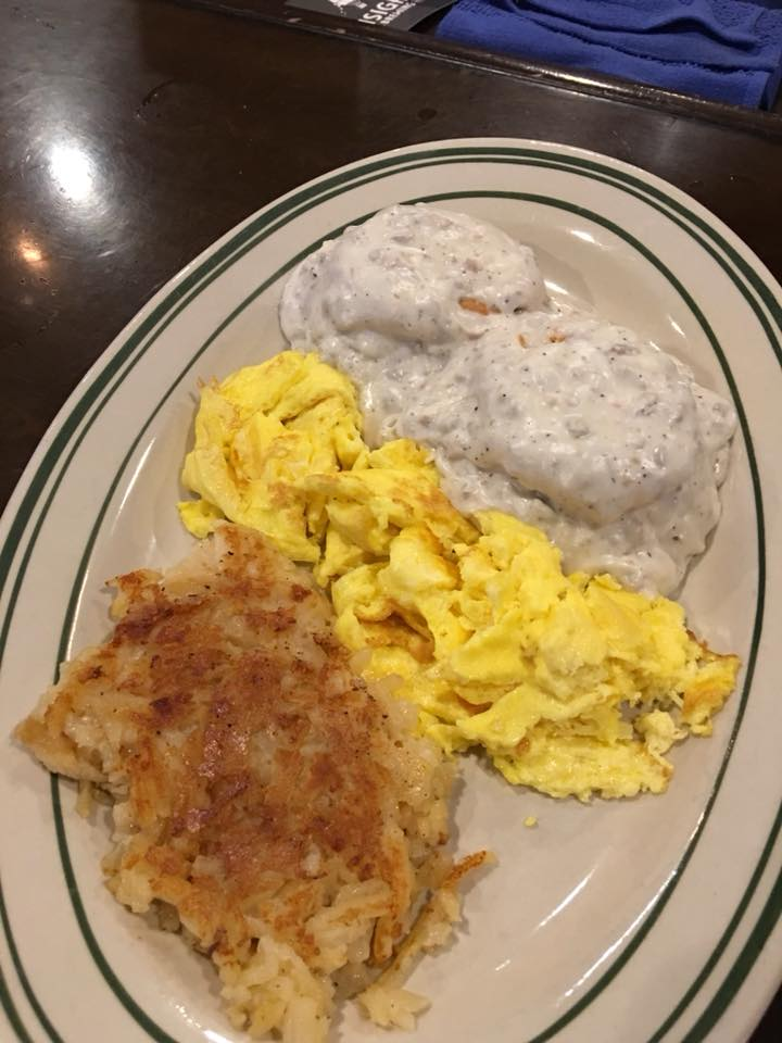 Scrambled eggs and hashbrowns served with grits