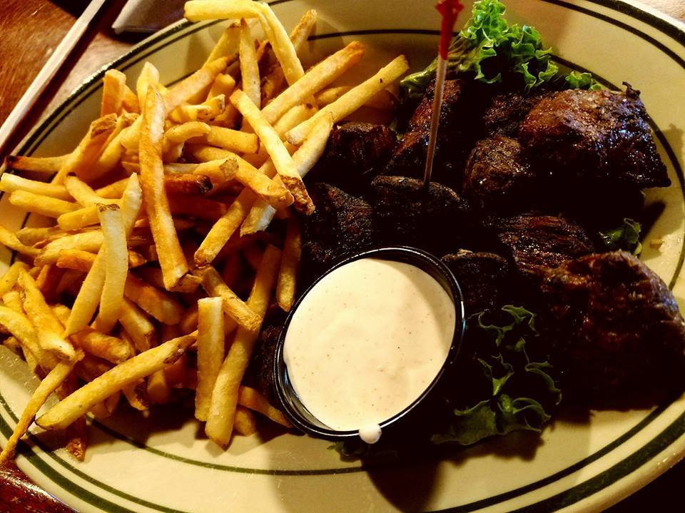 Steak and French fries accompanied by ranch dipping sauce