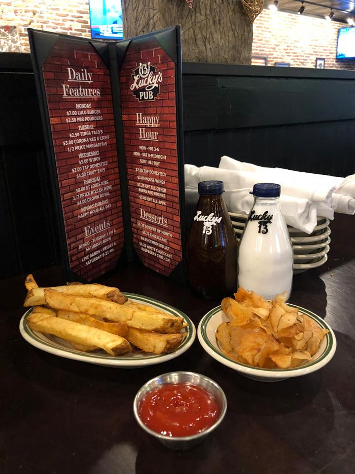 Potato Wedges and chips accompanied by dipping sauce and 2 beverages
