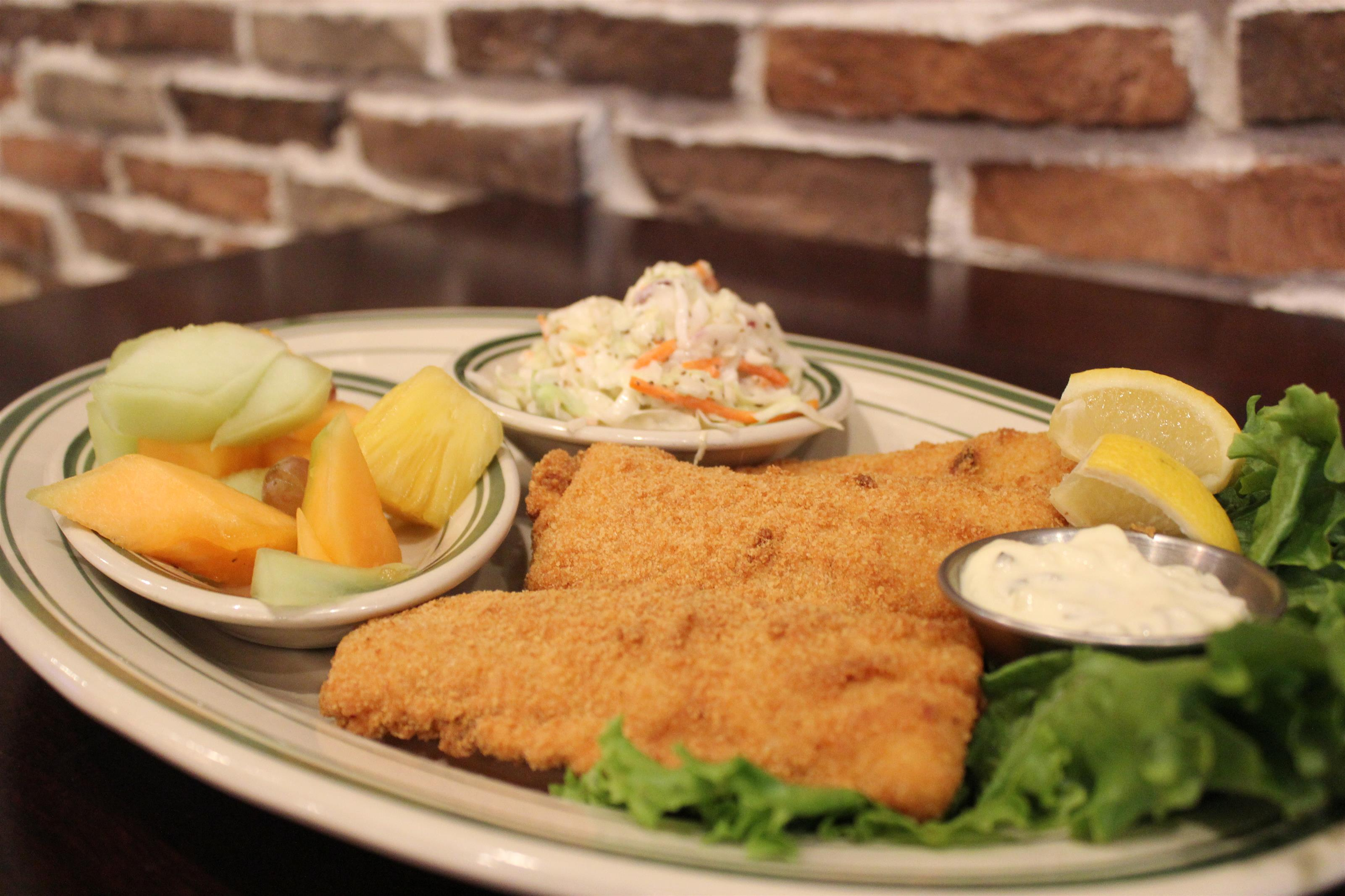 Battered fried fish with cole slaw and fruit