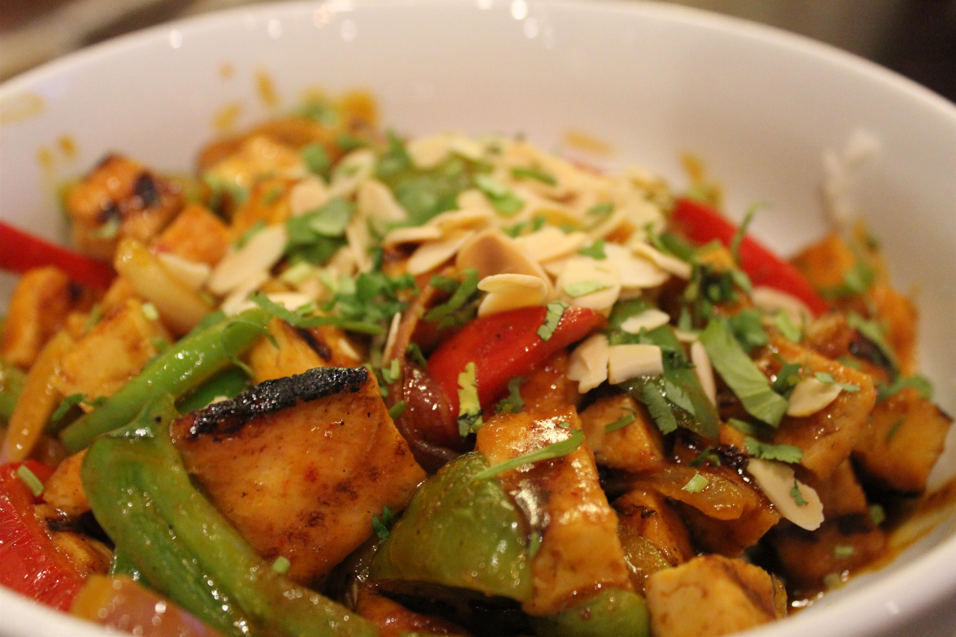 Coconut Curry. Grilled chicken, Curry sauce, onions, peppers, carrots, tomatillos, almonds, cilantro & fresh jasmine rice