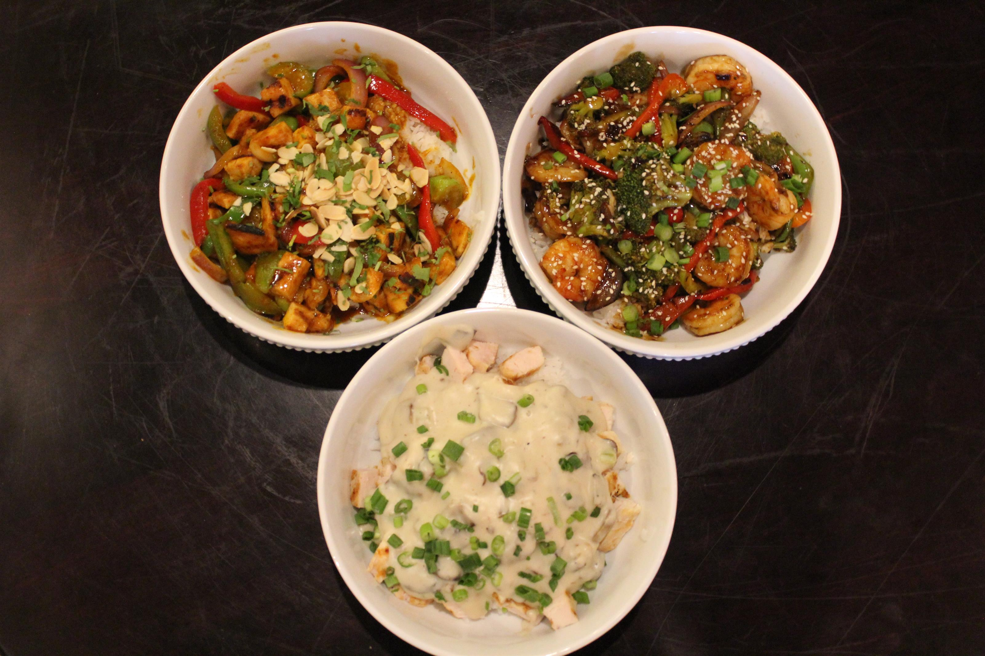 variety of stir-fry shrimp and chicken dishes with broccoli, peppers, onions.