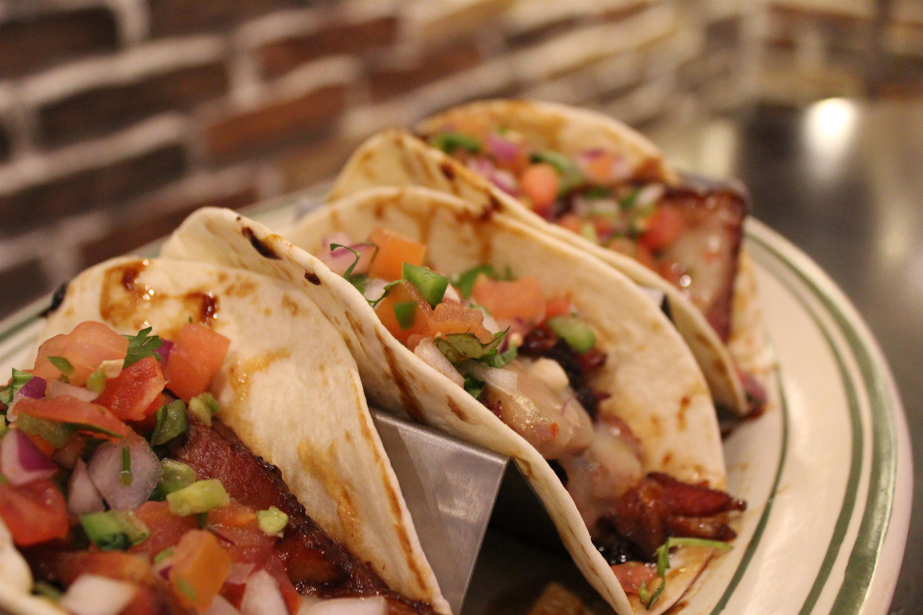 Street tacos. Brisket, pepper jack cheese, pico de gallo, crispy corn tortilla chips, salsa.