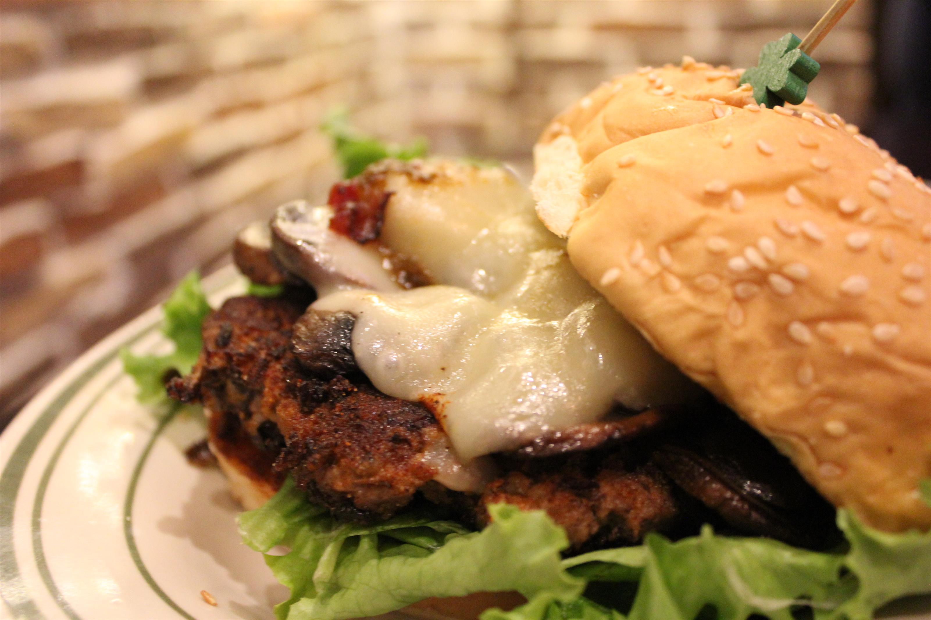 Hand crafted burger with sauteed mushrooms and swiss cheese.
