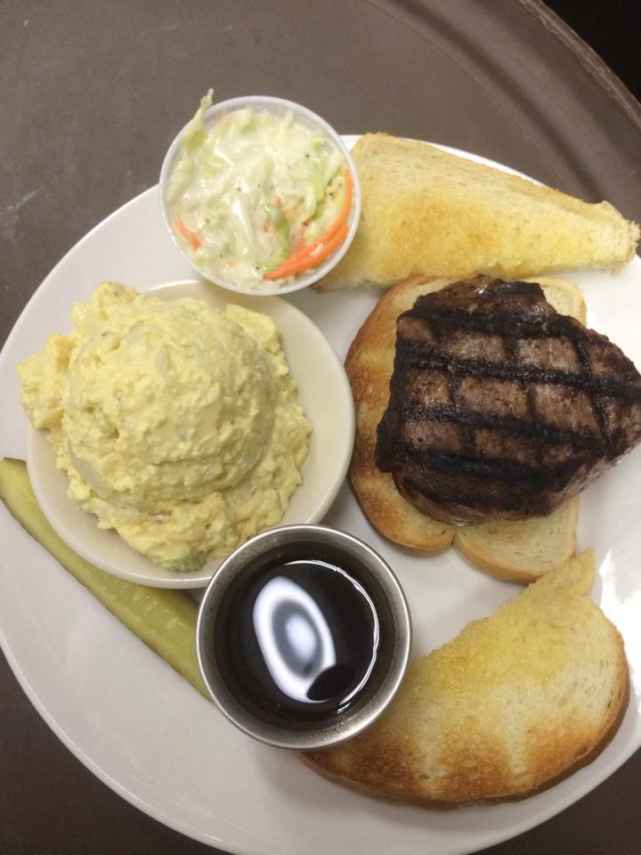 Grilled steak on toasted bread, served with puree and a side dressing