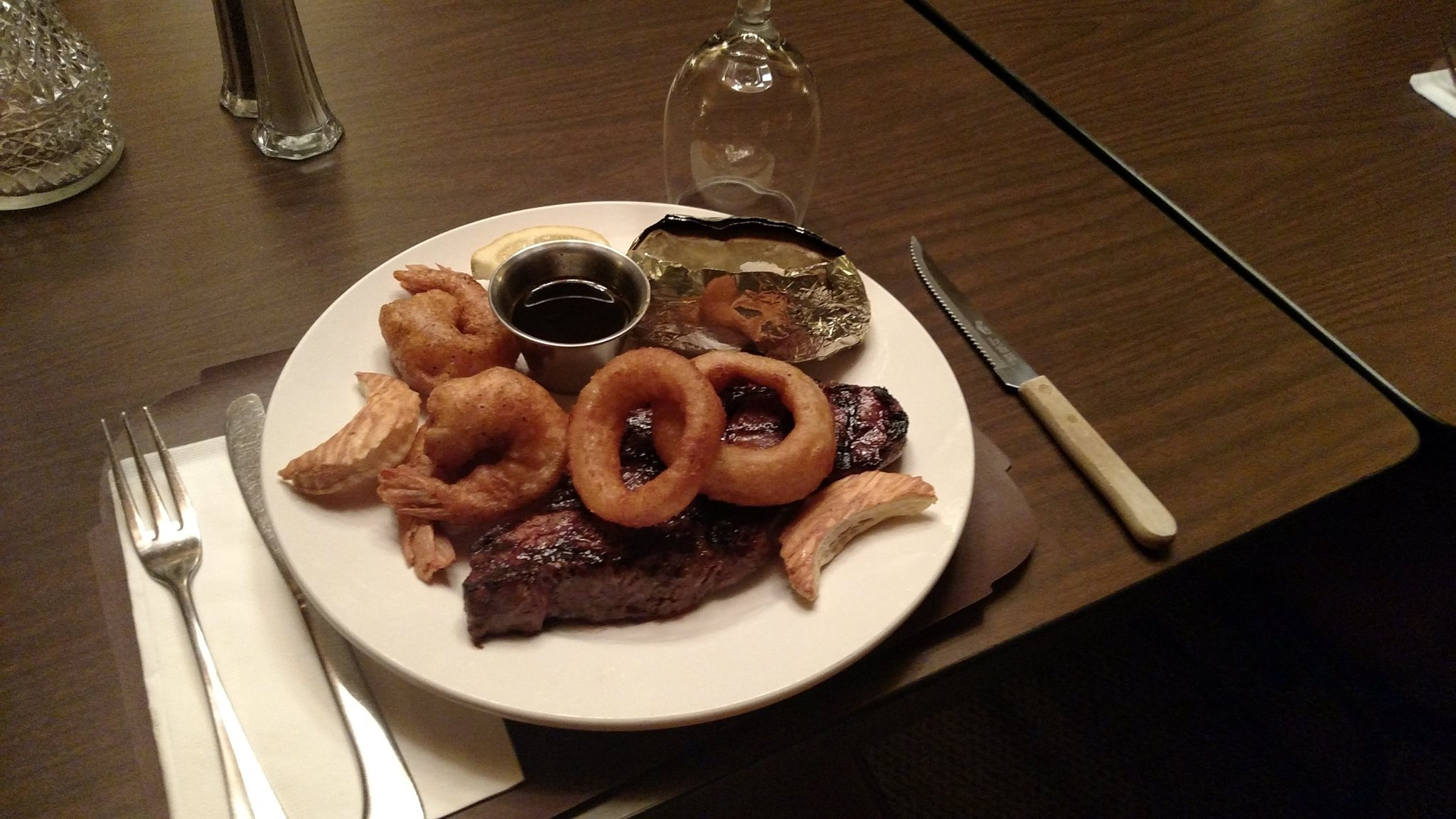 Grilled steak served with onion rings