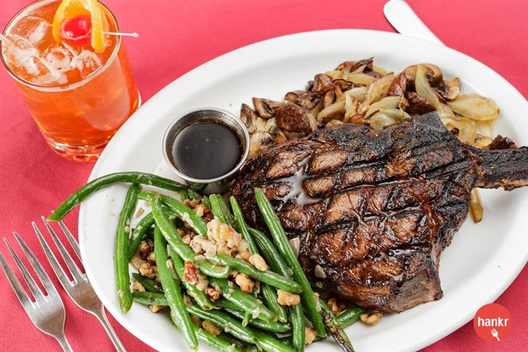 grilled steak with a side of green beans