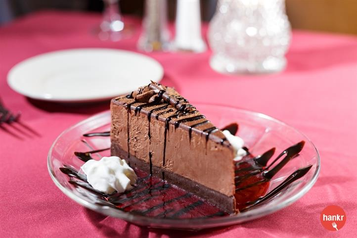 A piece of chocolate cake with chocolate syrup