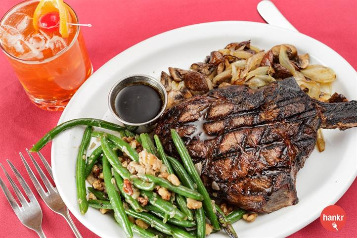 Grilled Steak served with au jus, fried onions and green beans