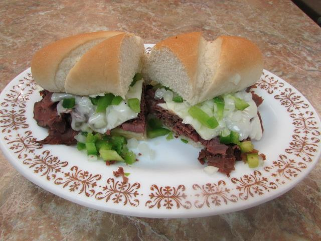 Thinly sliced Prime rib, green peppers, onions, swiss cheese on toasted French roll