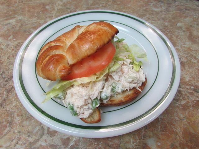 Chicken Salad, shredded lettuce an a tomato on a Croissant