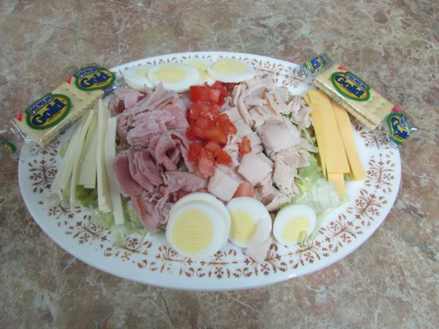 Salad with shredded lettuce, Ham, turkey, American & swiss cheese, lettuce, egg, tomato & crackers on the side