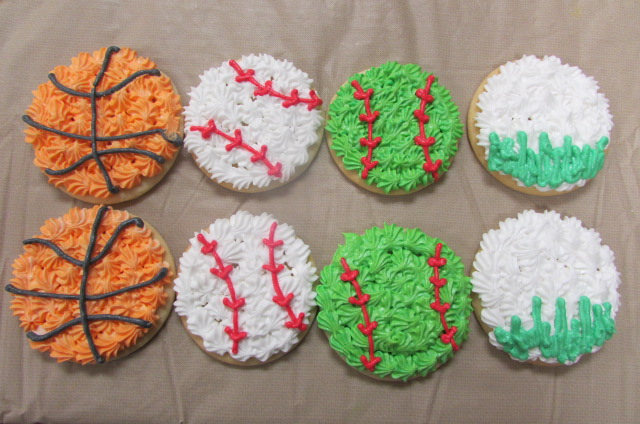 Cookies frosted to look like basketballs, baseballs, and tennis balls