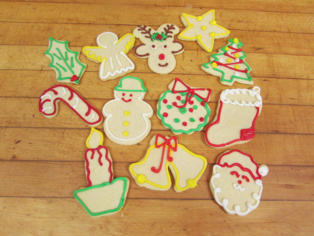 Assorted christmas shaped cookies decorated in frosting