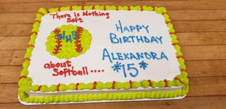 "Rectangle cake decorated with a softball that says ""there is nothing soft about softball"" and Happy Birthday Alexandra *15*"""
