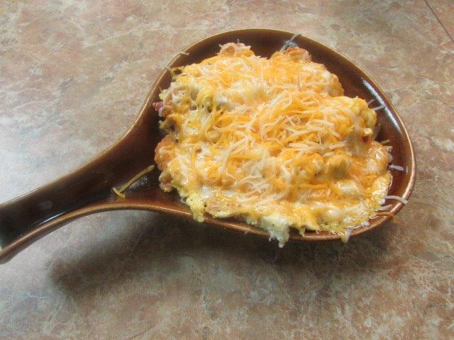 Skillet of food topped with melted shredded cheese