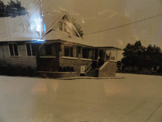 Old black and white image of the outside of the restaurant.
