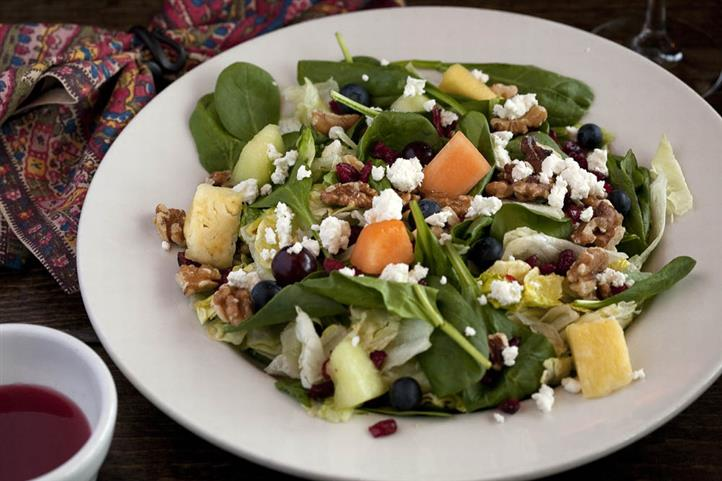 Salad of fresh mixed greens, goat cheese, walnuts, cranberries & mixed fruit