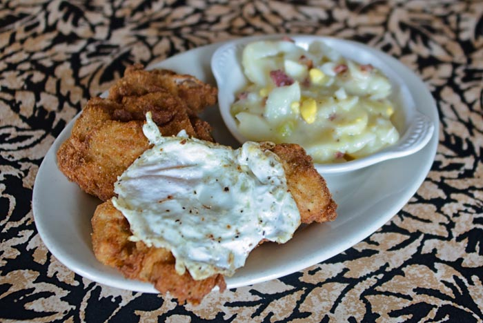 fried chicken with gravy and mashed potatoes