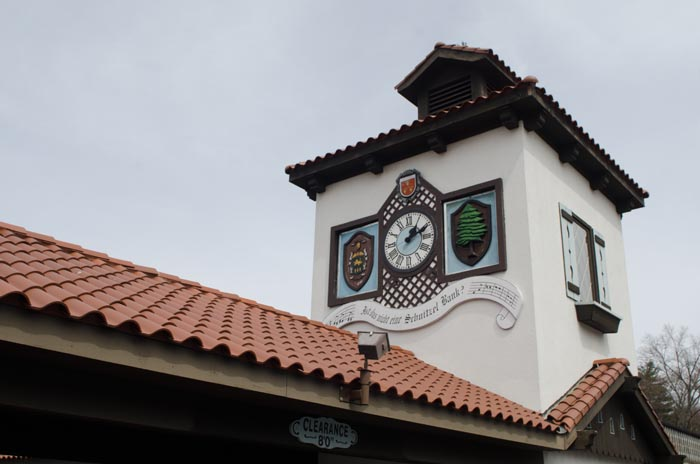exterior building clock with decorations