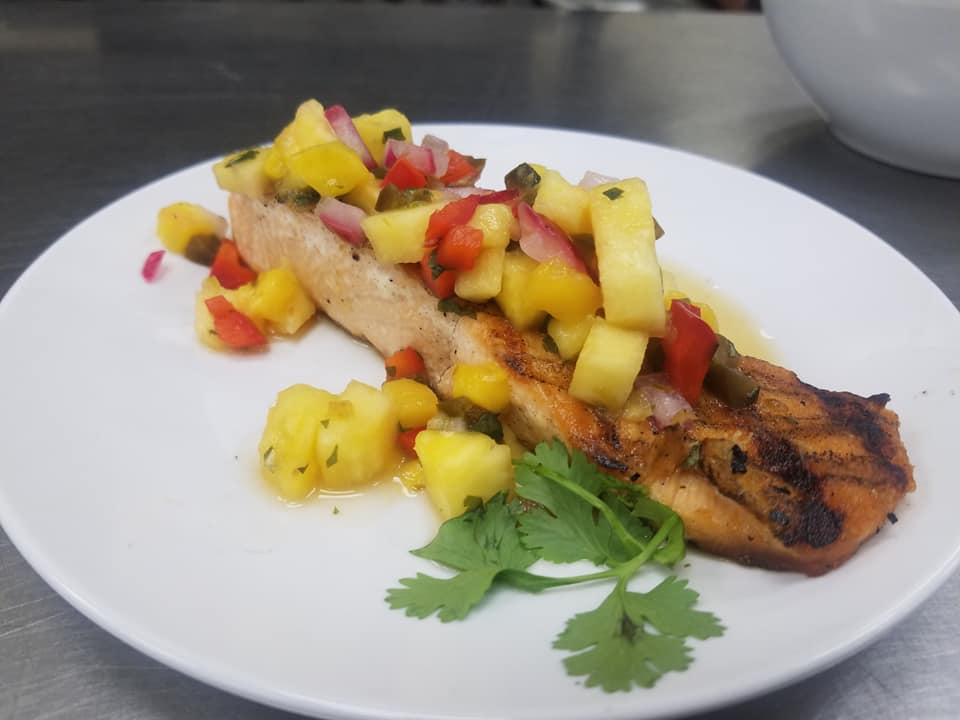 grilled salmon topped with pineapple