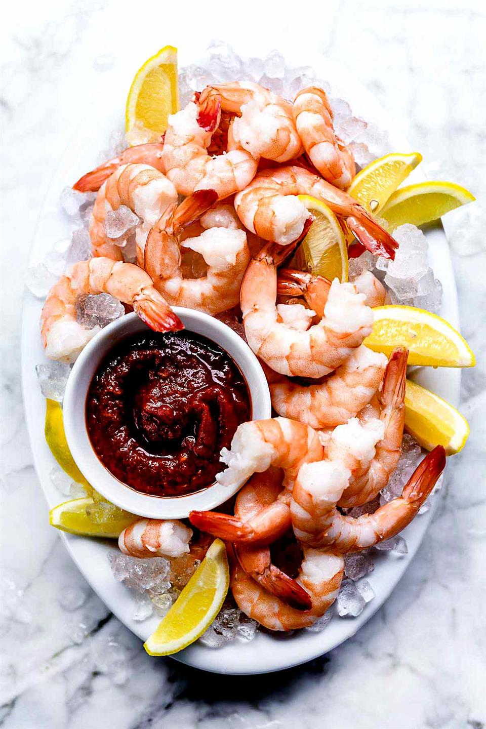 shrimp served on ice with cocktail sauce