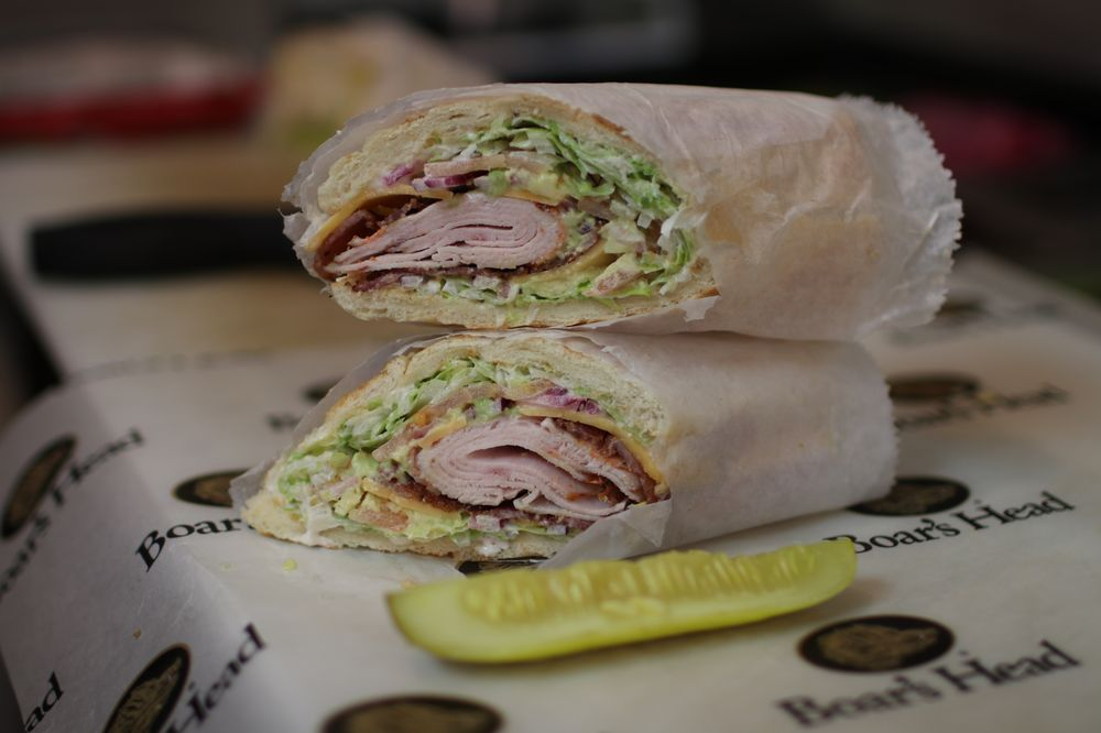 Wrap cut in half with turkey, cheese, lettuce, red onion and a pickle on the side.