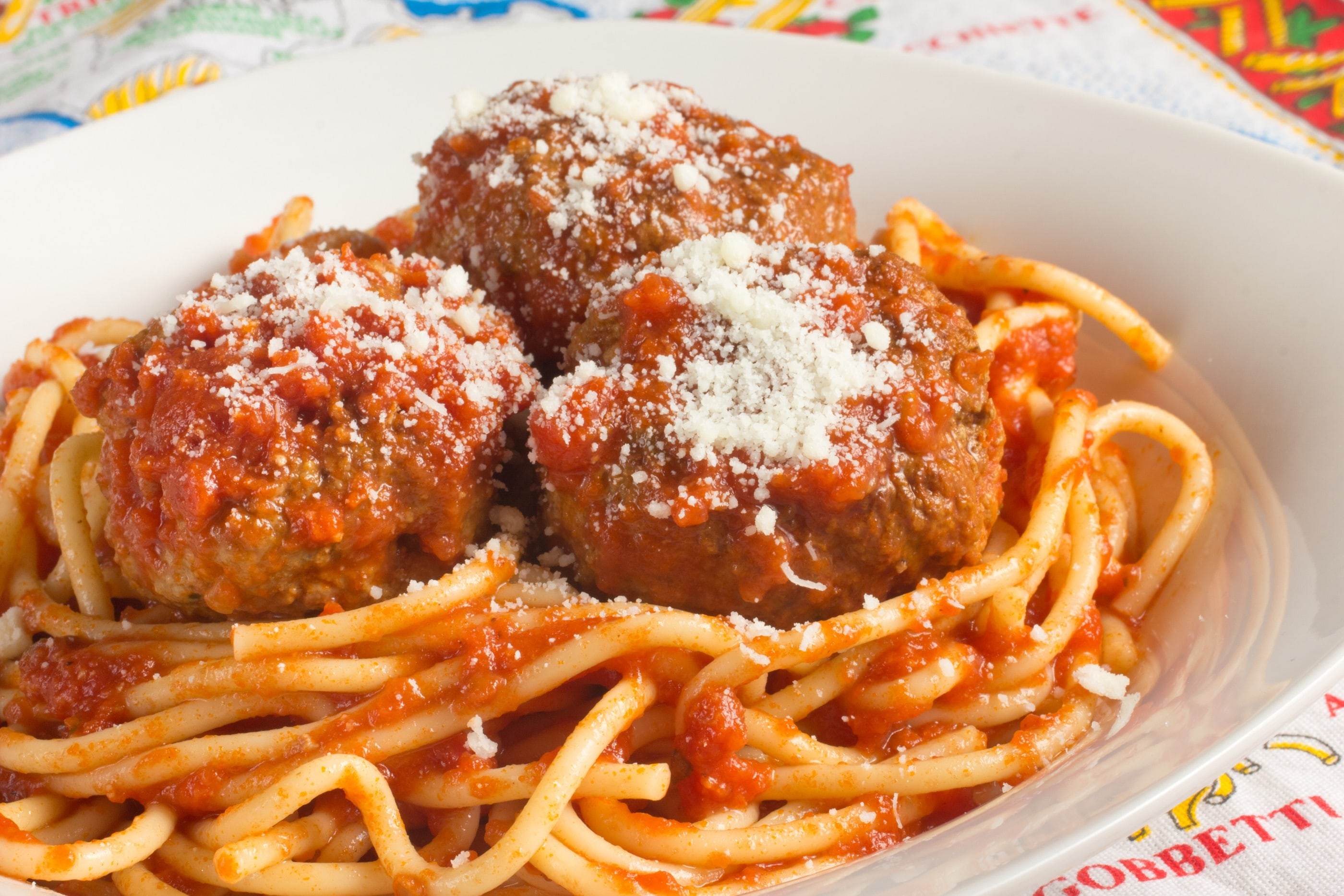 Spaghetti and meatballs in white dish