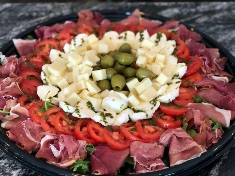 cheese, meat, olives, tomato platter