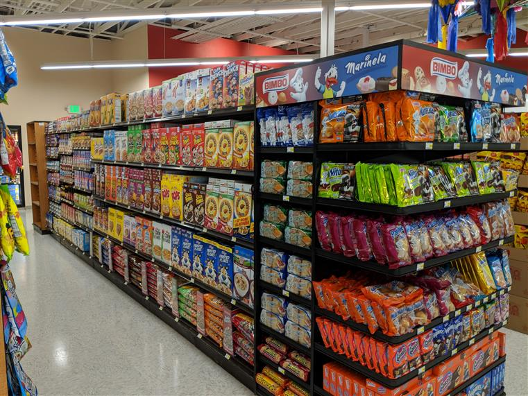 Market aisle with cereals, end cap with cookies and desserts