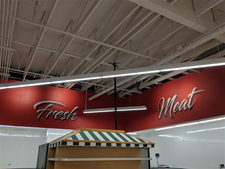 Fresh meat sign on wall inside market