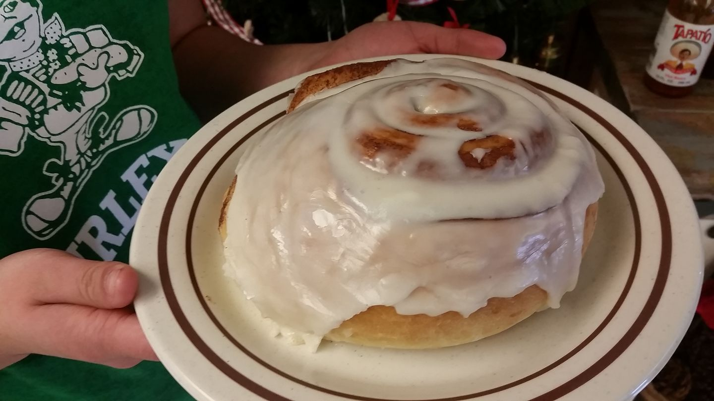cinnamon roll on a plate with icing