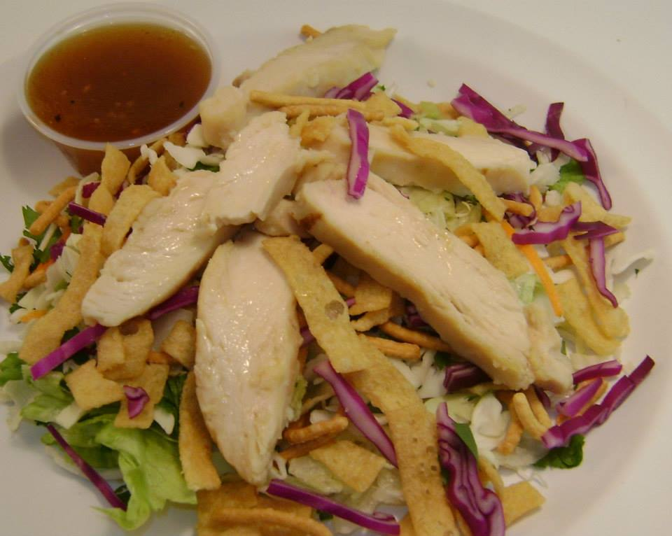 chicken salad with corn cips and dressing on the side