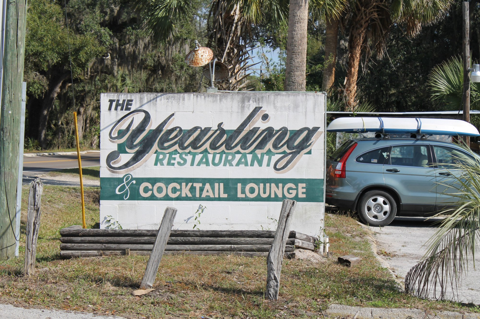the yearling restaurant outdoor signage next to their parking lot
