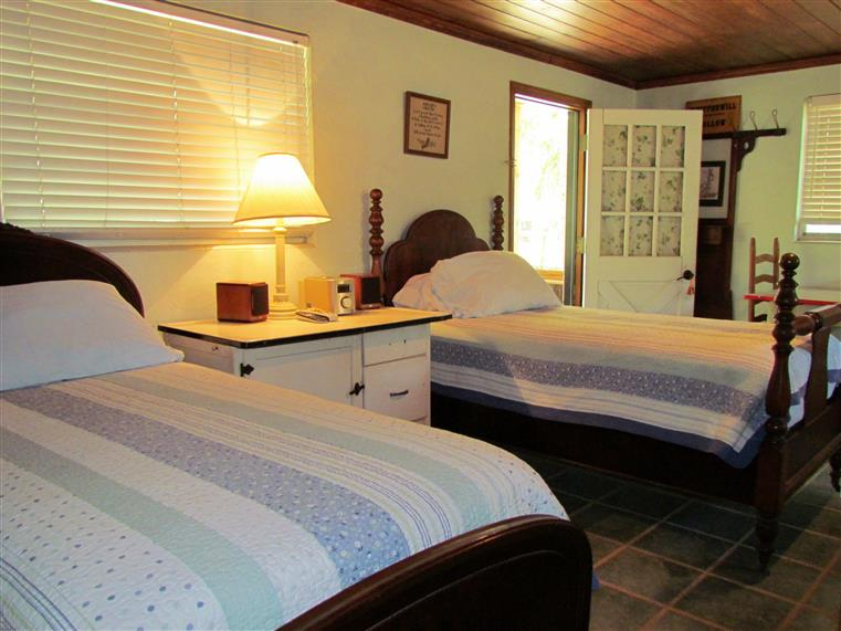 interior of whippoorwill cabin with twin beds and a night stand