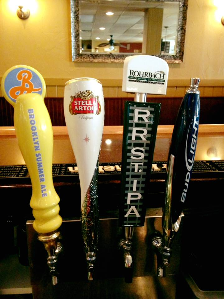 Beer taps labeled Brooklyn Summer Ale, Stella Artois, Rohbach IPA and Bud Light.