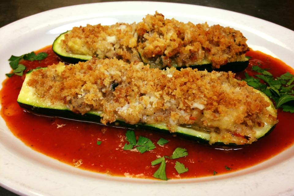 Stuffed Zucchini slices laying in sauce