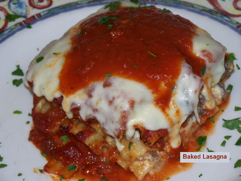 Baked lasagna covered in sauce and layered in cheese