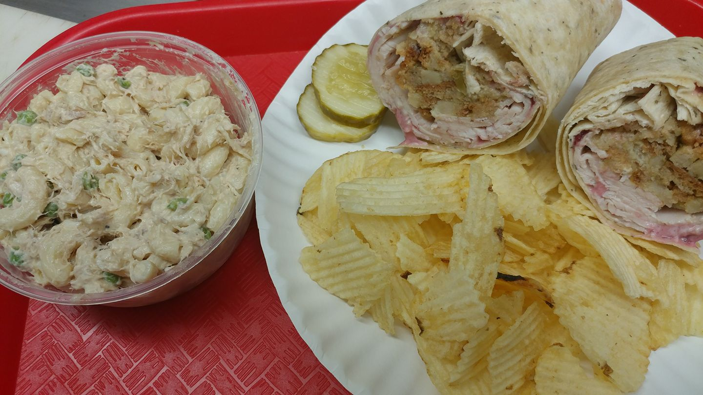 Chicken tortilla served with pickle, chips and cole slaw