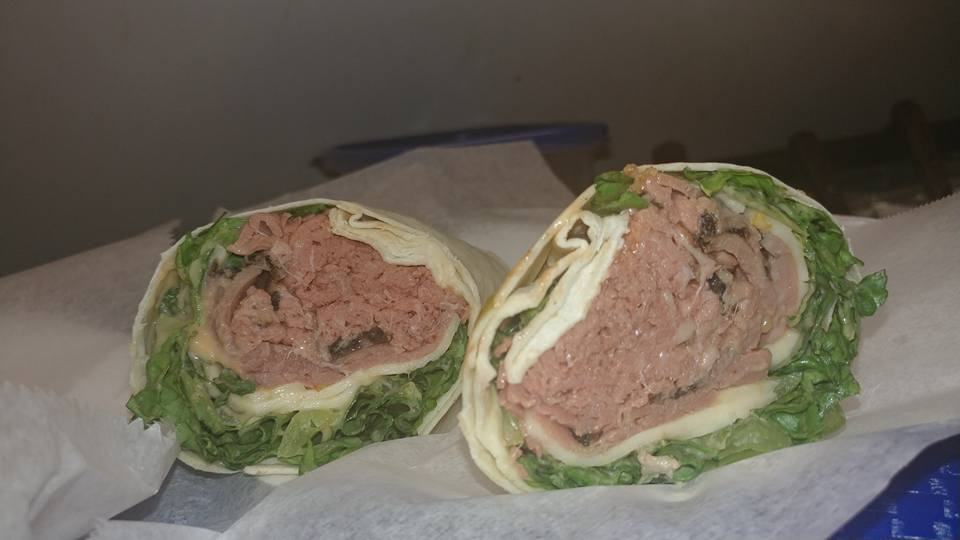 Wrap with ham, cheese, and lettuce