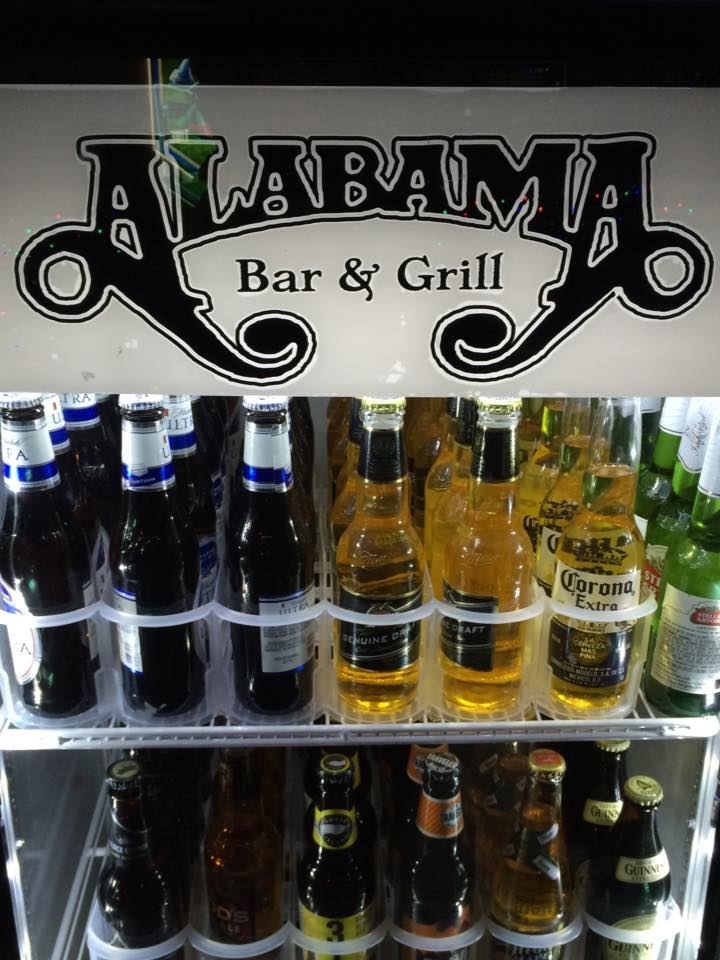 alabama bar & grill fridge stocked with various beer bottles