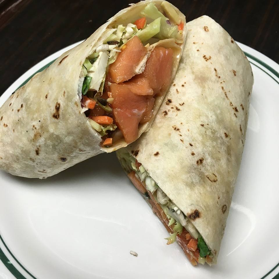 chicken wrap with lettuce and tomatoes on a plate
