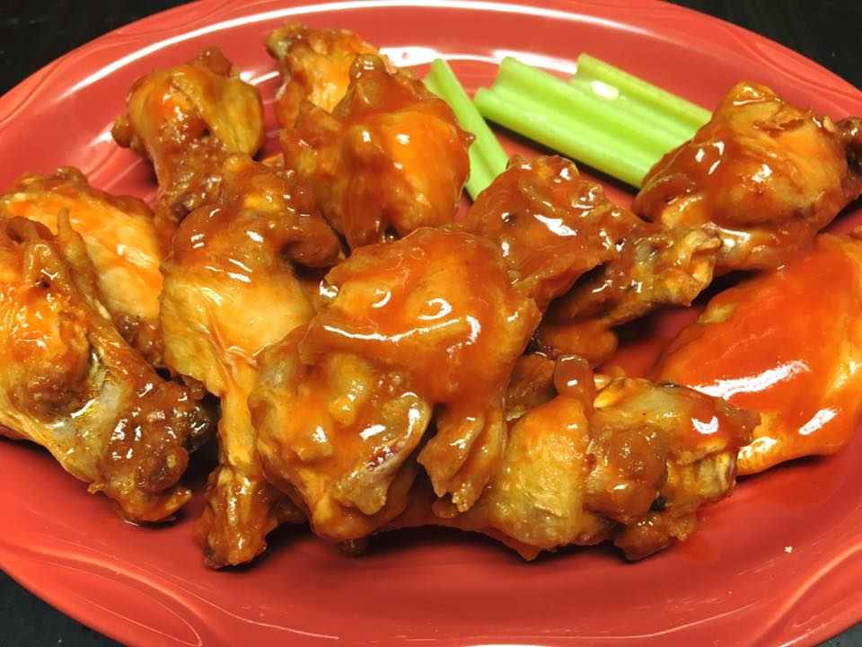 buffalo wings with sauce on a plate