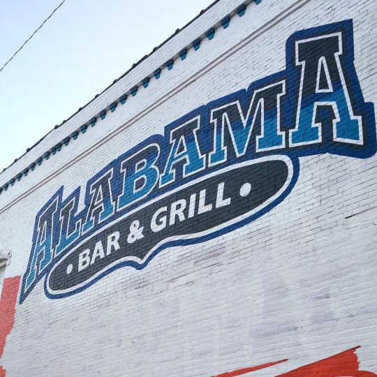 alabama bar & grill painted on side of restaurant