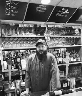 mark cosgrove standing behind the bar